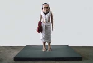The Overman (2012) by littlewhitehead Mannequin head, polyutherane, towels, boxing glove, glue, child mannequin, flip flops, wooden plinth 120 x 120 x 120cm Courtesy of Sumarria Lunn Gallery